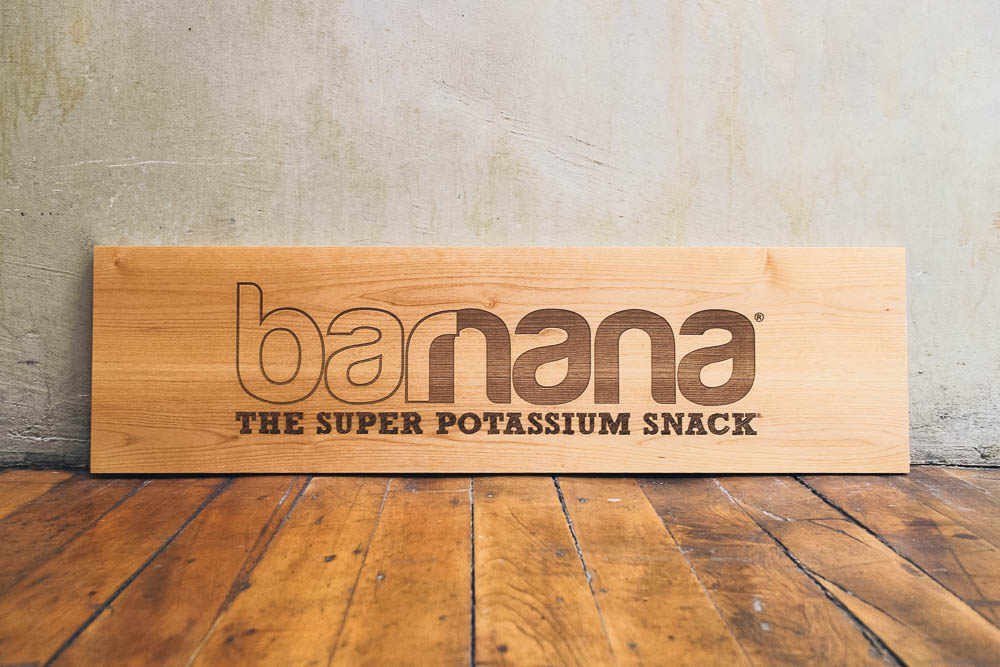 Etched wood sign for Barnana