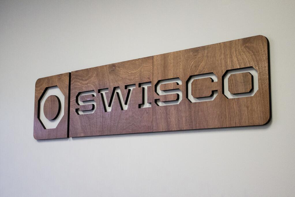 Swisco dark wood signage