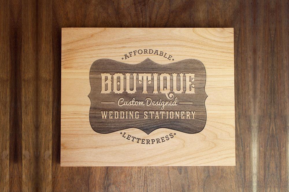 Laser etched wood sign for Boutique