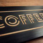 Laser etched black wood sign for KP's Coffee Shack