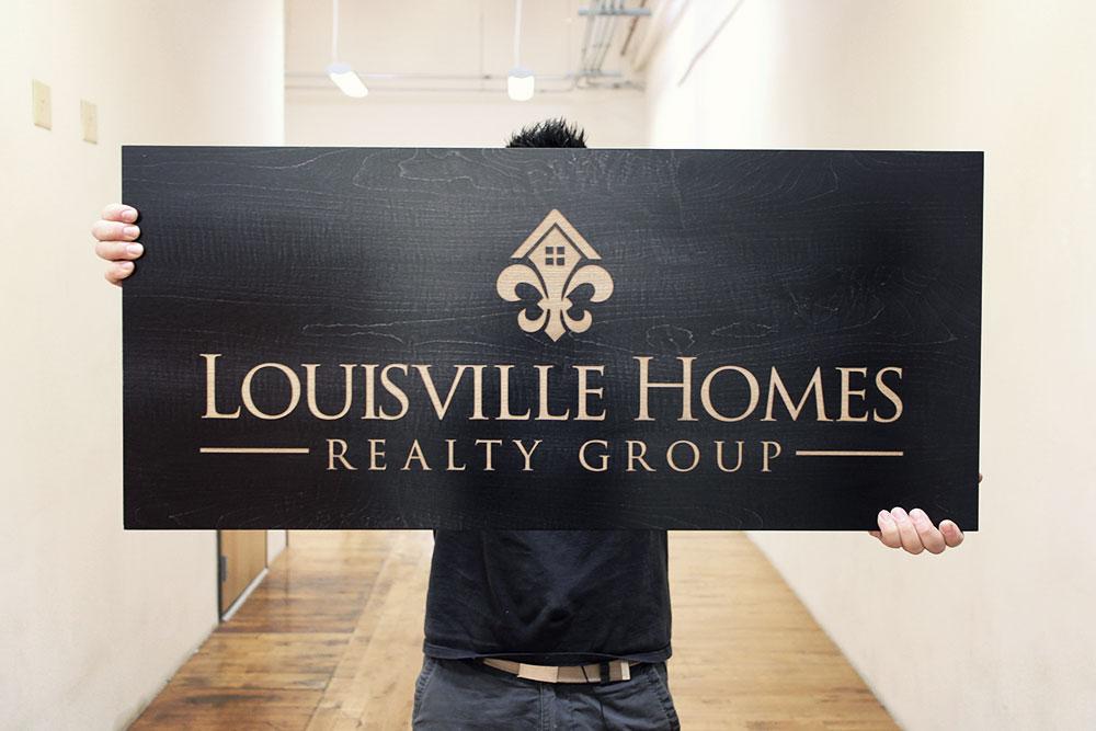 Laser etched black wood sign for louisville homes