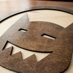 Round wood sign for Tiny Little Monster