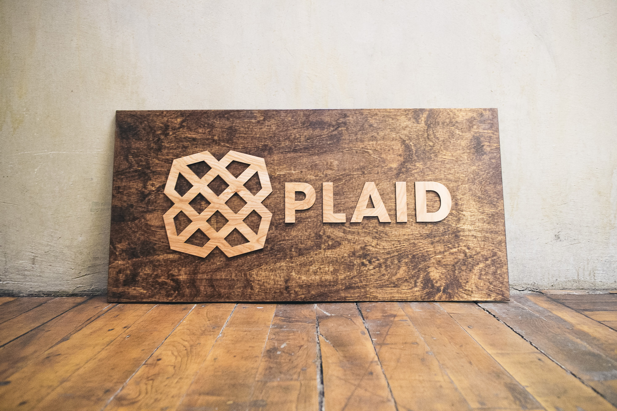 Wood sign for Plaid Technologies