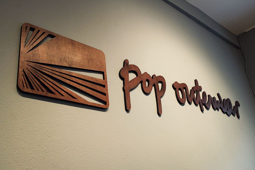 Wood Store Sign for Pop Outerwear