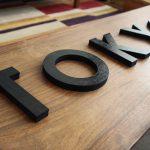 TOKYObay black wood signage