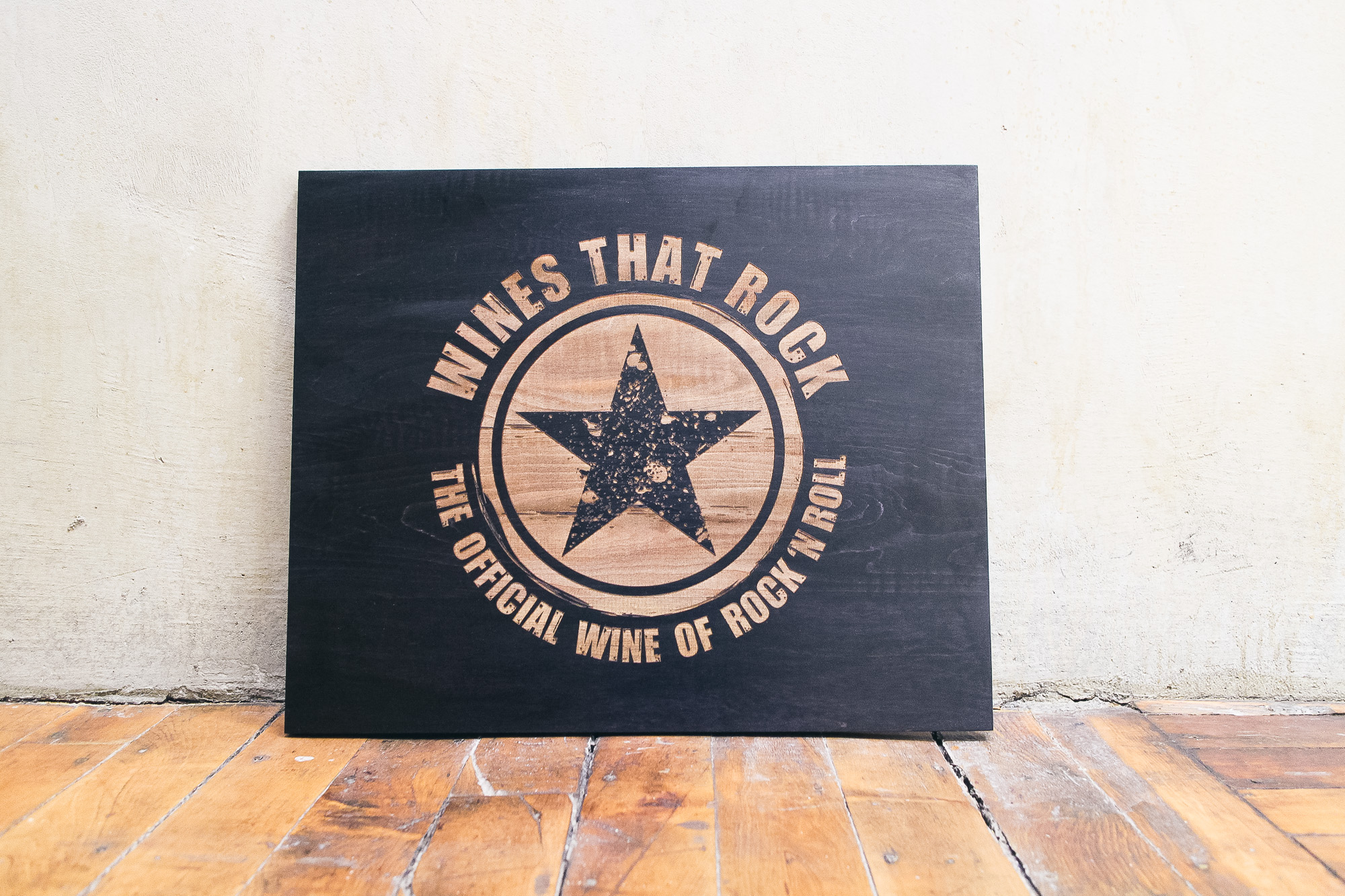 Laser etched black wood sign for Wines That Rock