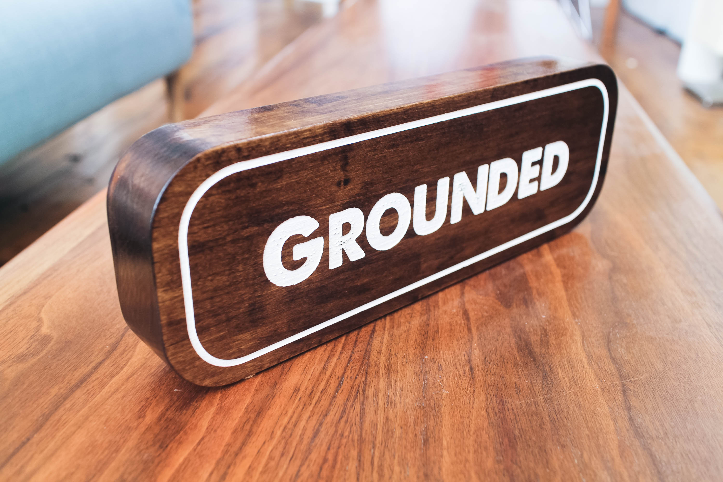 Grounded tabletop walnut wood sign