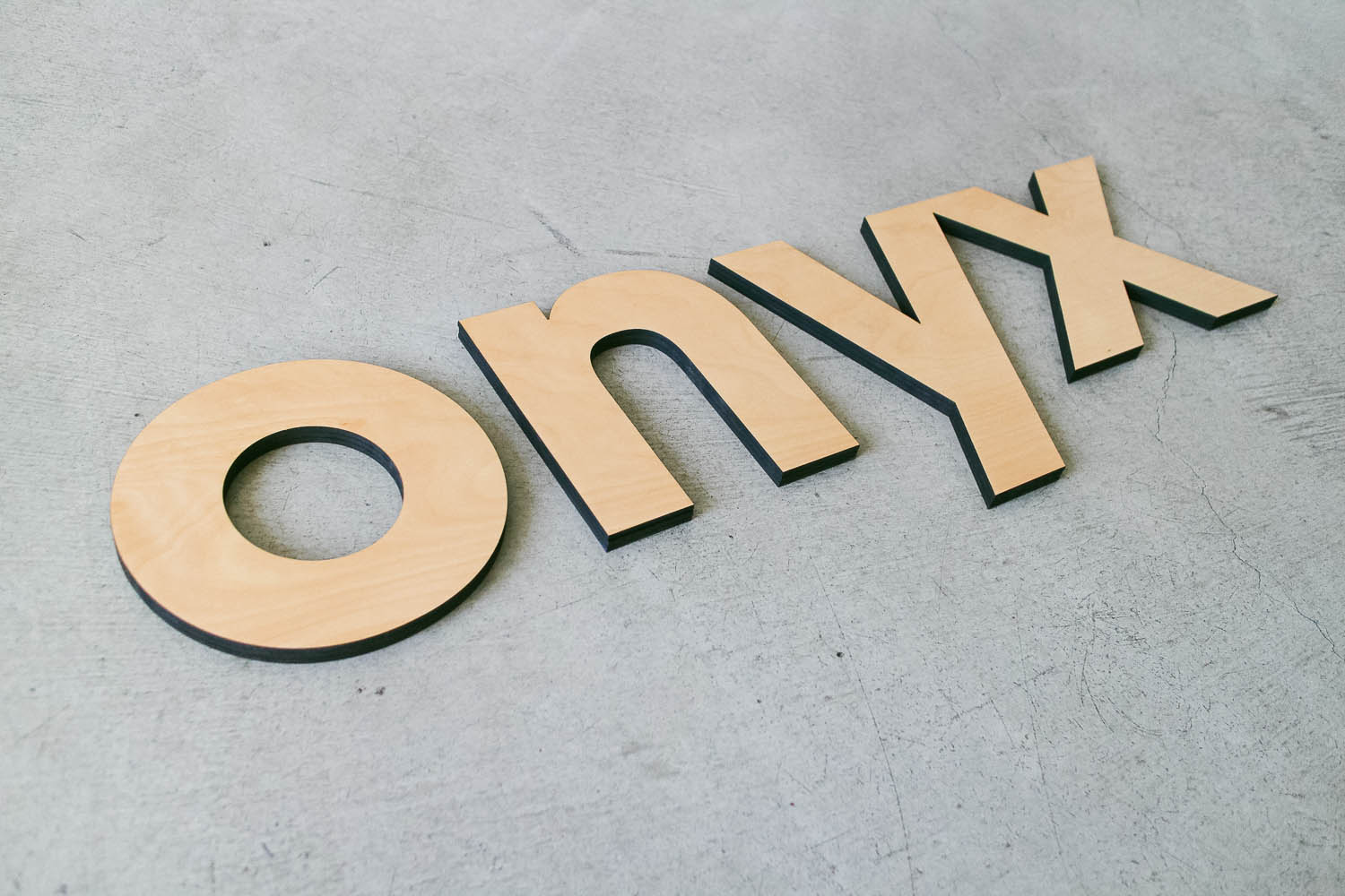 Onyx cutout wood sign