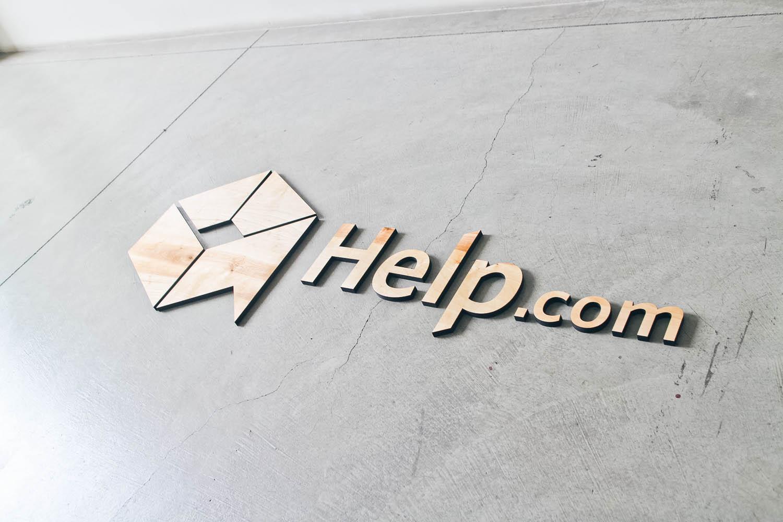 Help.com floating wood lobby sign