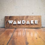 Wandake metal and wood raised sign