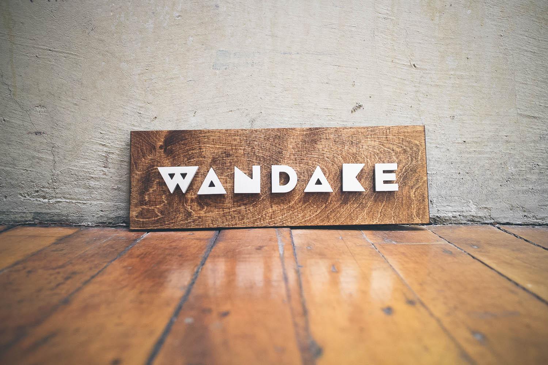 Wandake metal and wood raised sign