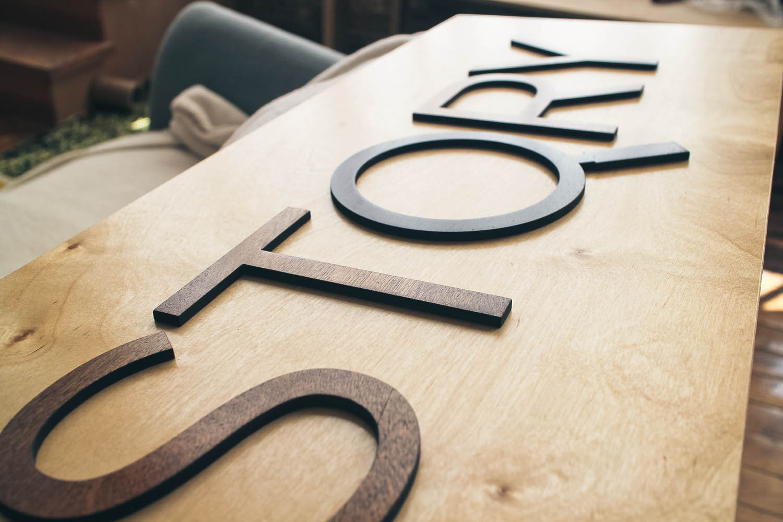STQRY raised wood sign