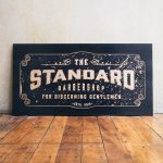 The Standard Barbershop Etched Black Wood Sign