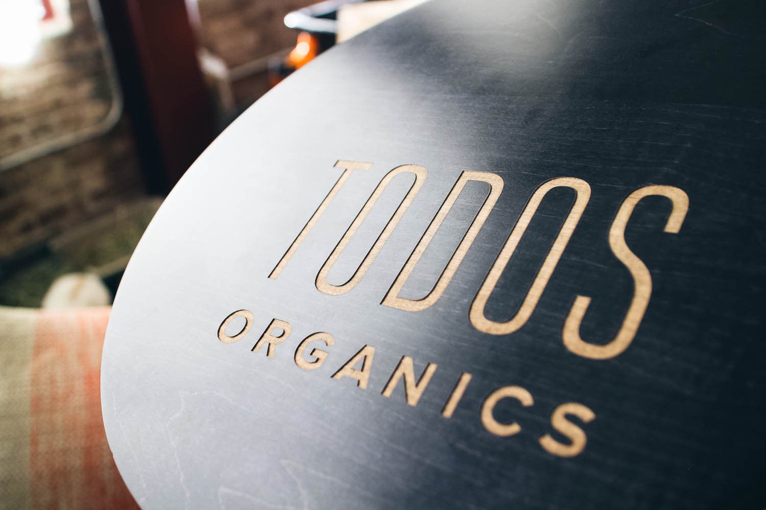 Todos Organics Black Round Etched Sign