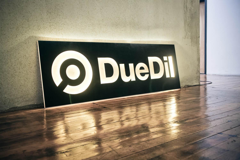 DueDil illuminated logo wood sign