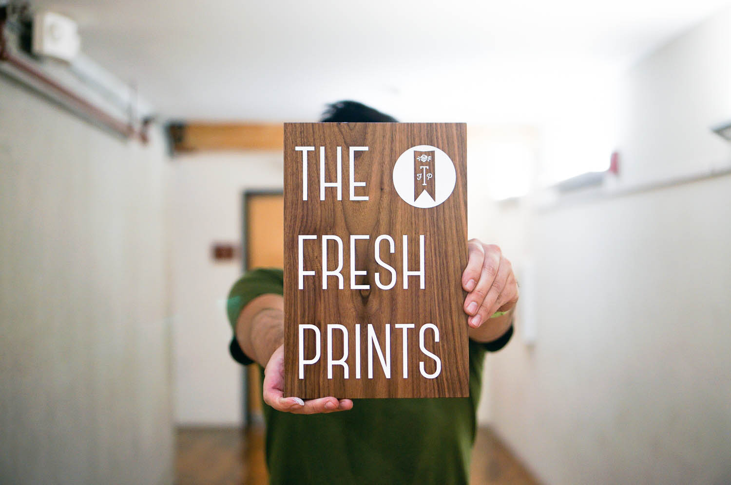 The Fresh Prints walnut sign