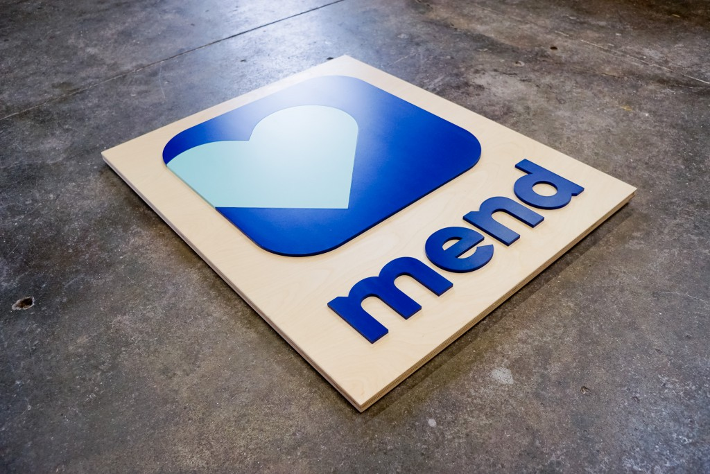 Mend App Logo Sign