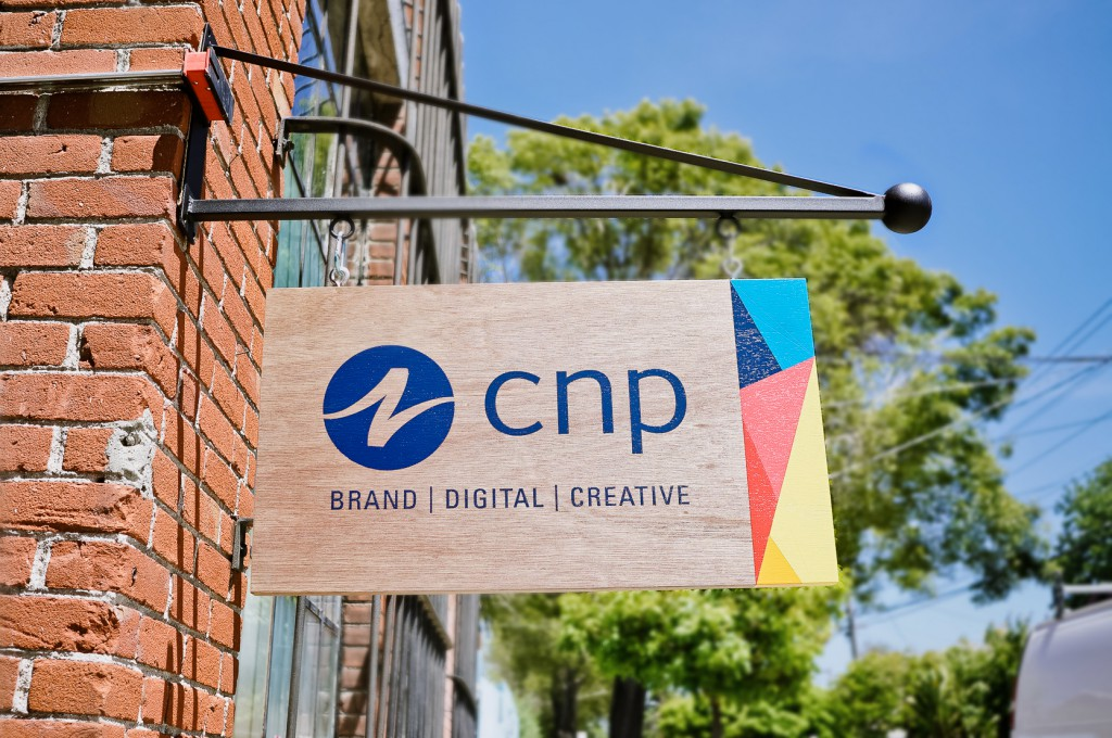 CNP wood and color hanging blade sign