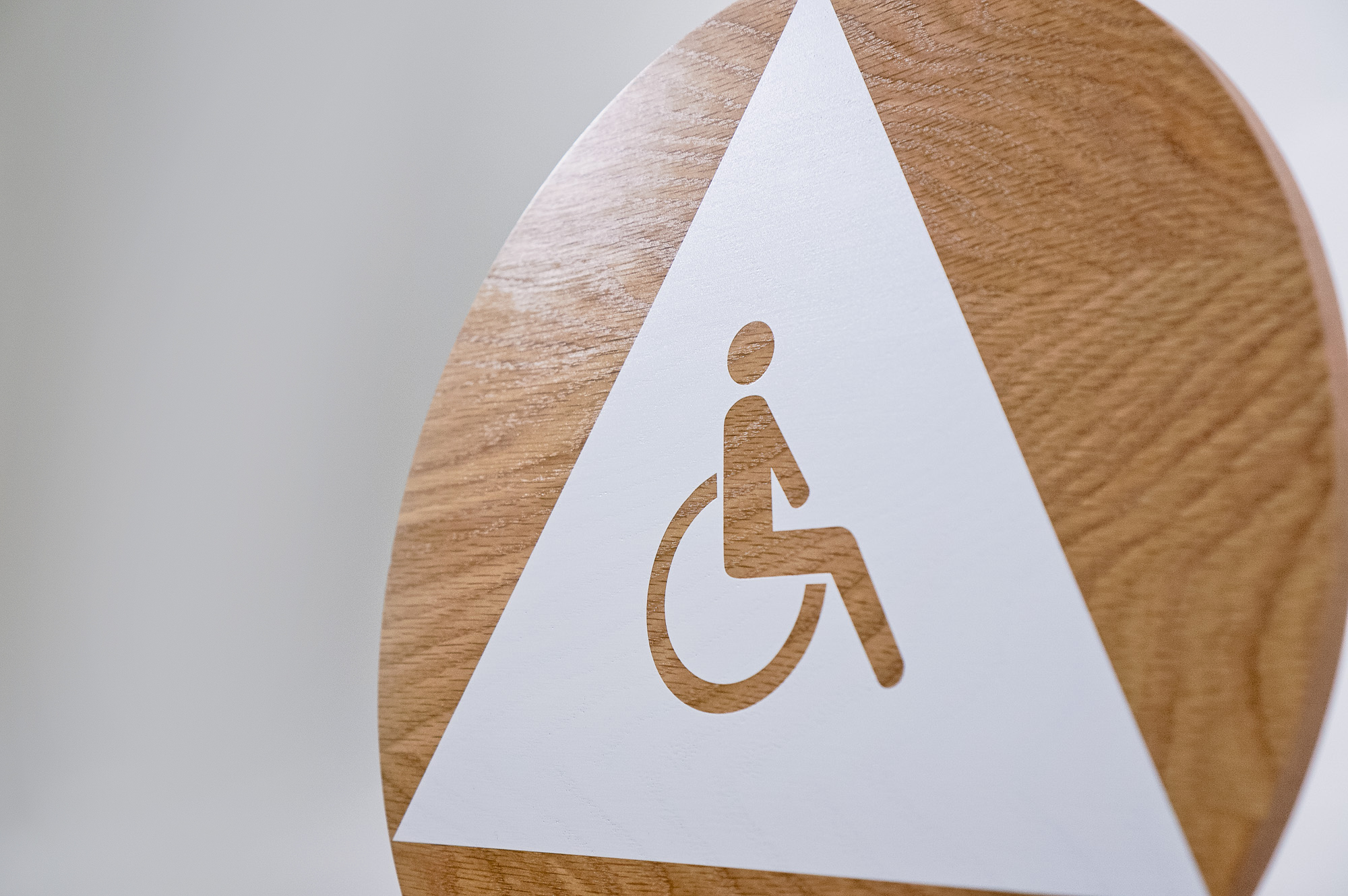Slack modern wood and white restroom door sign