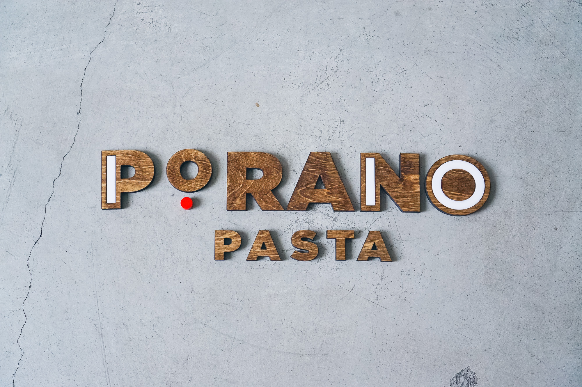 Porano Pasta dark wood and colored wood restaurant wall sign