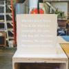 thumbtack manifesto sign - white matte vinyl on wood