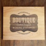 Laser etched wood sign for Boutique