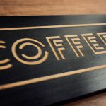 Laser etched black wood sign for KP's Coffee Shack