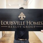 Laser etched black wood sign for louisville homes