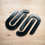 Black wood sign for SquareSpace