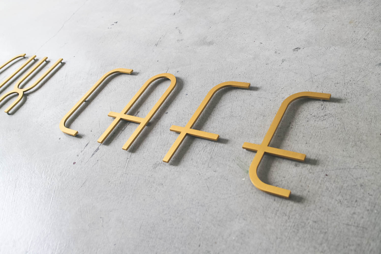 25 Cafe Gold Metal Sign