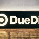 DueDil illuminated logo wood sign