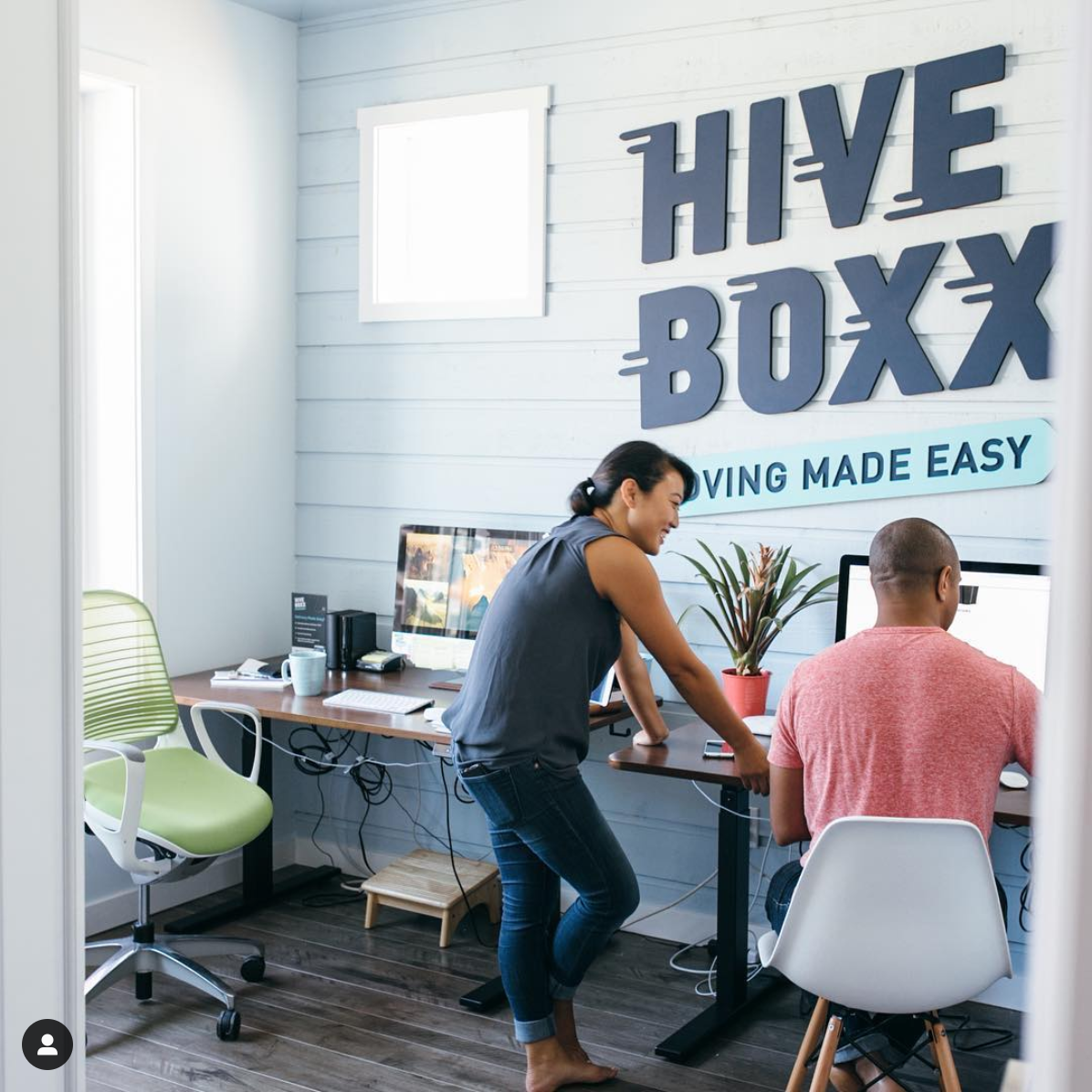 Matte blue sign for HiveBoxx, a moving box rental company in Seattle, WA
