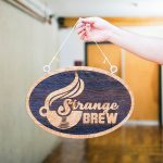 strange brew hanging etched sign