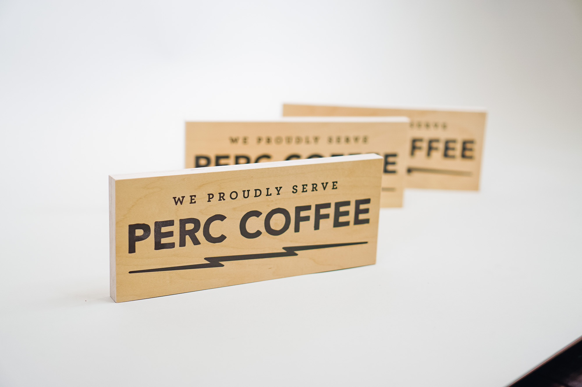 Wood tabletop retail signs for Perc Coffee, a premium coffee roaster in the heart of beautiful Savannah, GA