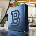 b black tabletop sign