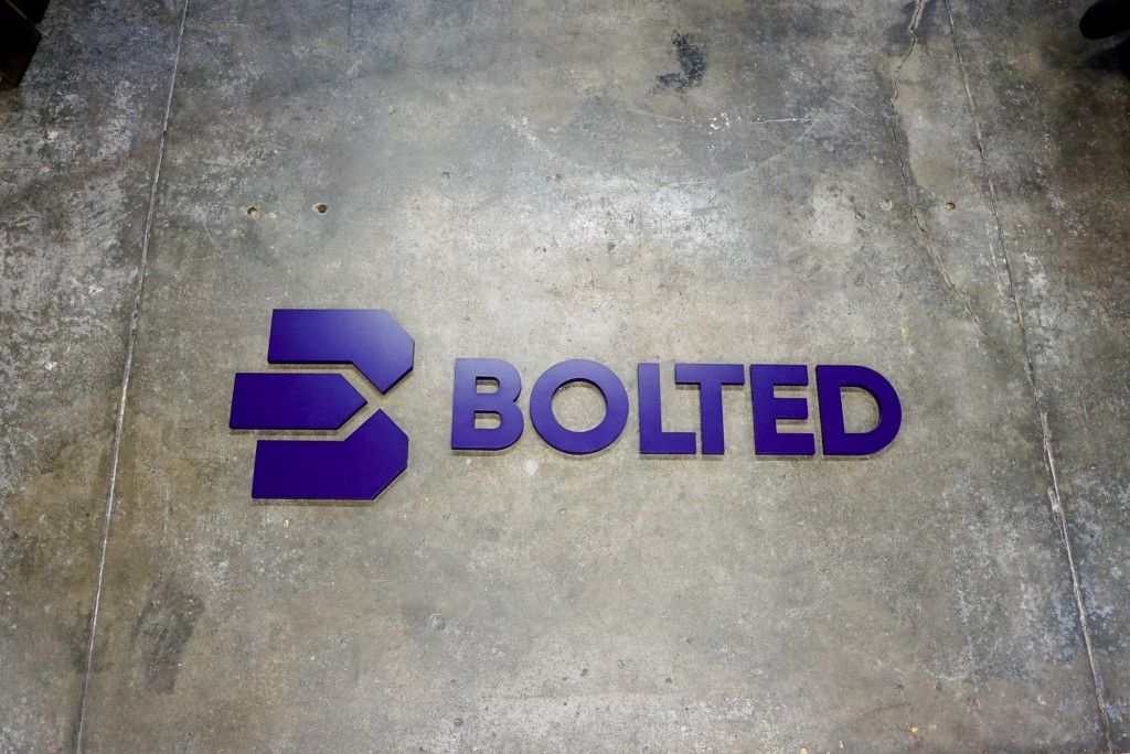 Bolted purple wall sign