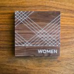 CNP walnut bathroom signs