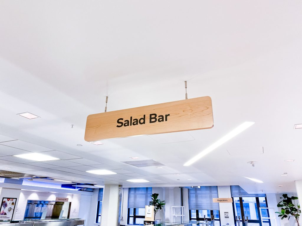 Suspended wood signage for the cafeteria of Thumbtack, an online service that matches customers with local professionals.