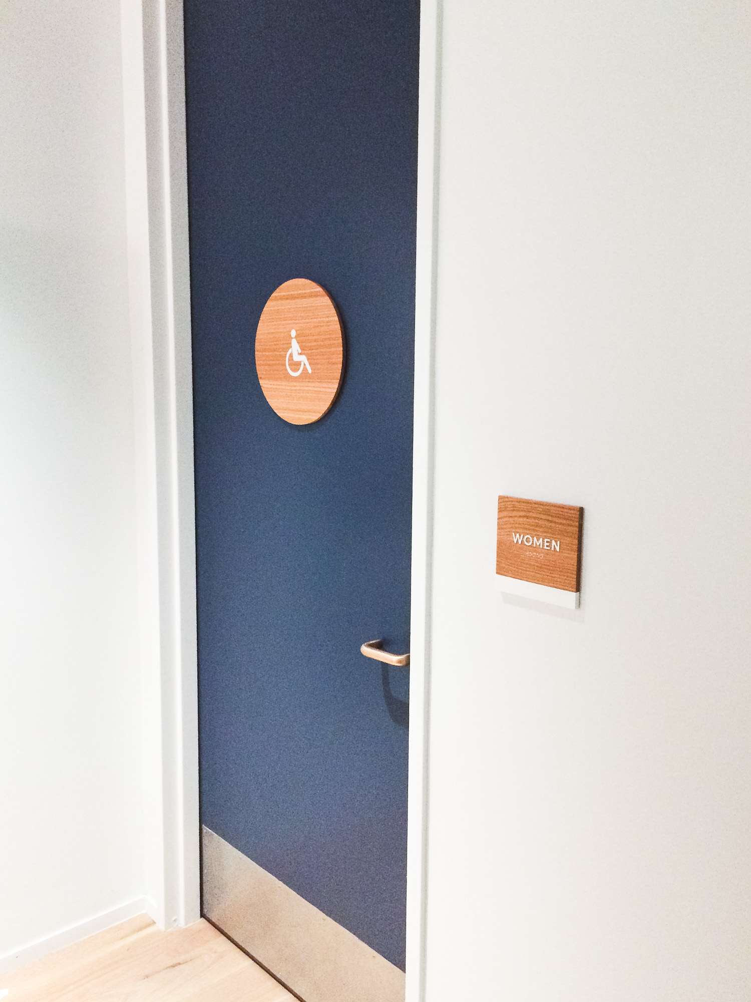 White-painted wood, California ADA signs for the office of Slack, a cloud-based set of proprietary team collaboration tools and services.