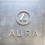 Aura acrylic and walnut backed wood sign