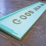 Good Juju Ink Portable modern Stationery Tradeshow Sign in teal and gold