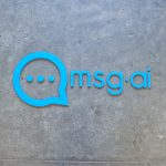 msg.ai light blue tech/startup lobby logo sign