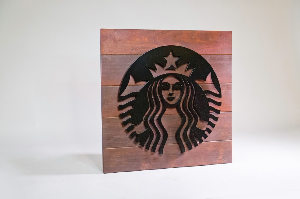 Starbucks outdoor cafe blade sign at Zephyr Walk - Wood Slat Epay with black metal artwork
