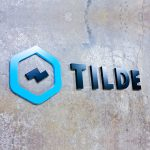 tilde black and teal tech startup modern lobby wall sign