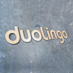 duolingo large light wood logo floating wall sign