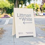 Littman + White Modern Whitewashed Gallery A-frame Sign with arrow and black text
