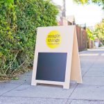 Simple Things modern light wood A-frame with color logo and chalkboard