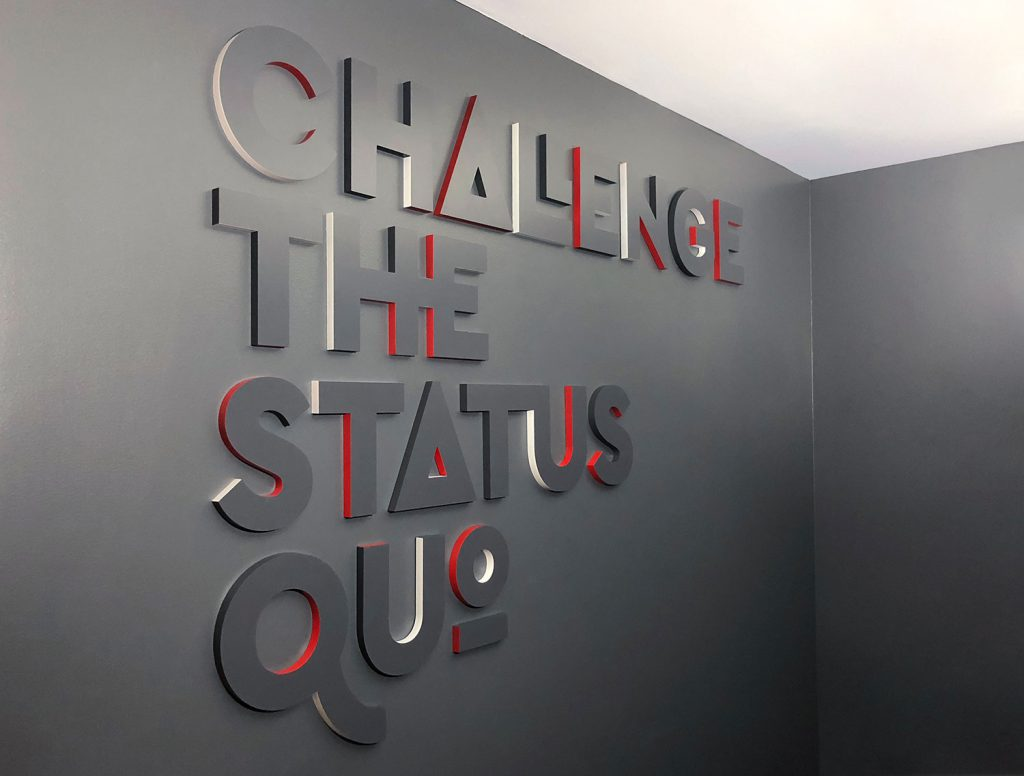 Challenge The Status Quo Lobby Sign at Envoy