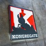 Illuminated propaganda style sign in red, white, and black sign for Kongregate, a gaming company.