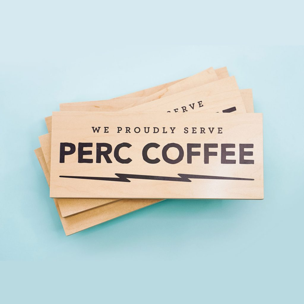 One of several wood retail signs for Perc Coffee, a coffee roaster based in Savannah, GA.